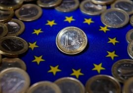 A picture shows one-euro coins in Lille on August 25, 2014. AFP PHOTO/PHILIPPE HUGUEN        (Photo credit should read PHILIPPE HUGUEN/AFP/Getty Images)