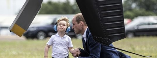 Prince William with son Prince George during a visit to the Royal International Air Tattoo at RAF Fairford