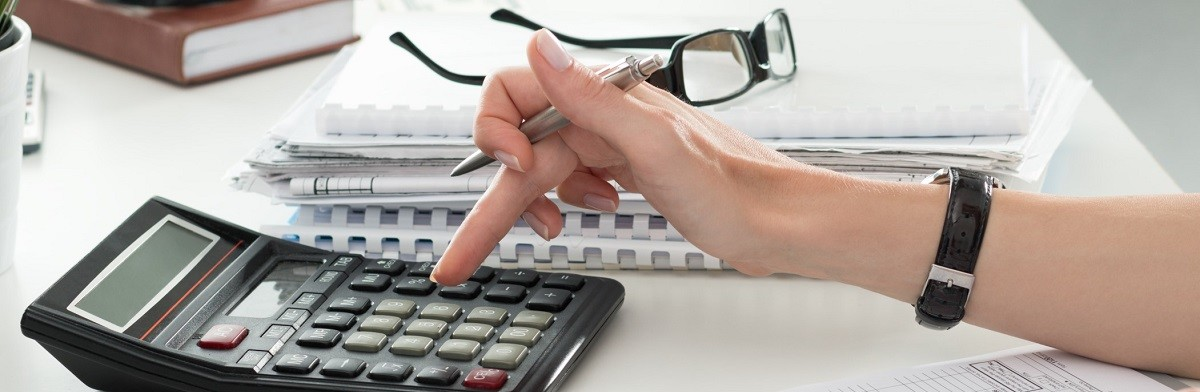 Close up of female accountant or banker making calculations