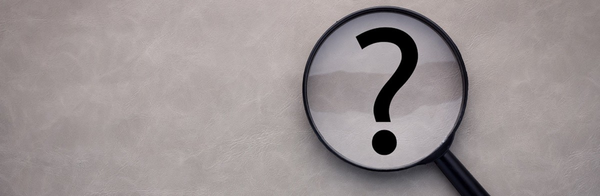 magnifying glass and a question mark on the leather background