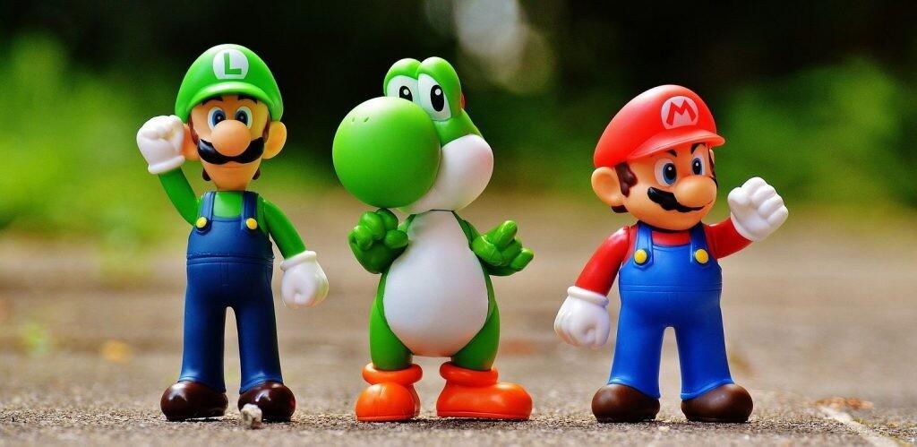 Mario con su hermano Luigi y su amigo Yoshi