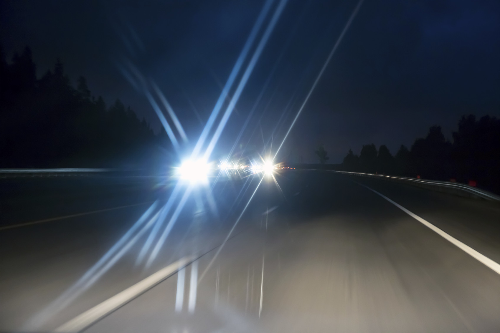 oncoming cars on highway in twilight time