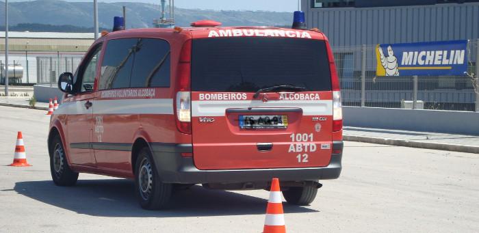 Passei um sinal vermelho por causa de uma ambulância.