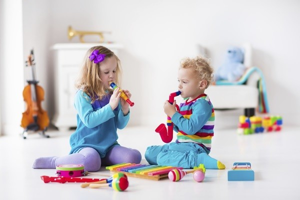 Children with music instruments. Musical education for kids. Colorful wooden art toys. Little girl and boy play music. Kid with xylophone, guitar, flute, violin. Early development for toddler and baby