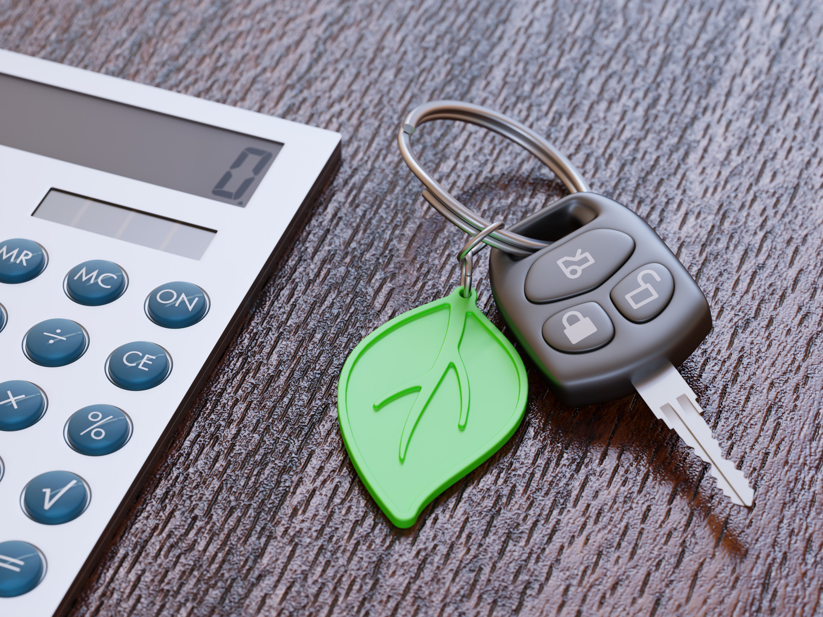 Car loan calculation concept with car keys and green leaf keychain