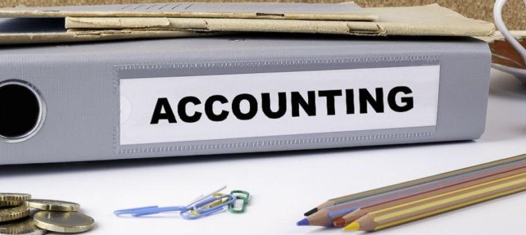 Accounting - folder on white office desk.