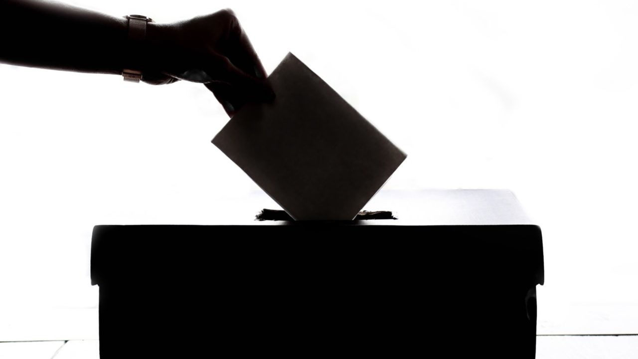 Person voting at a polling station. Open government.