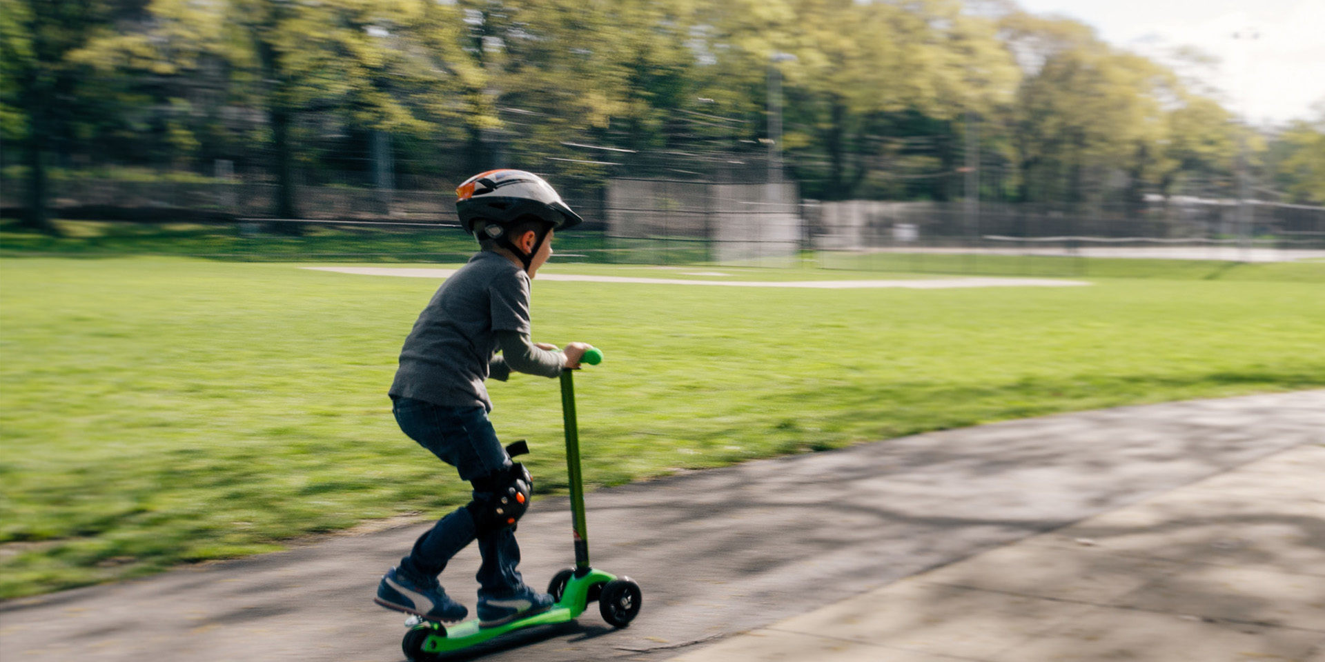 kid with a scooter