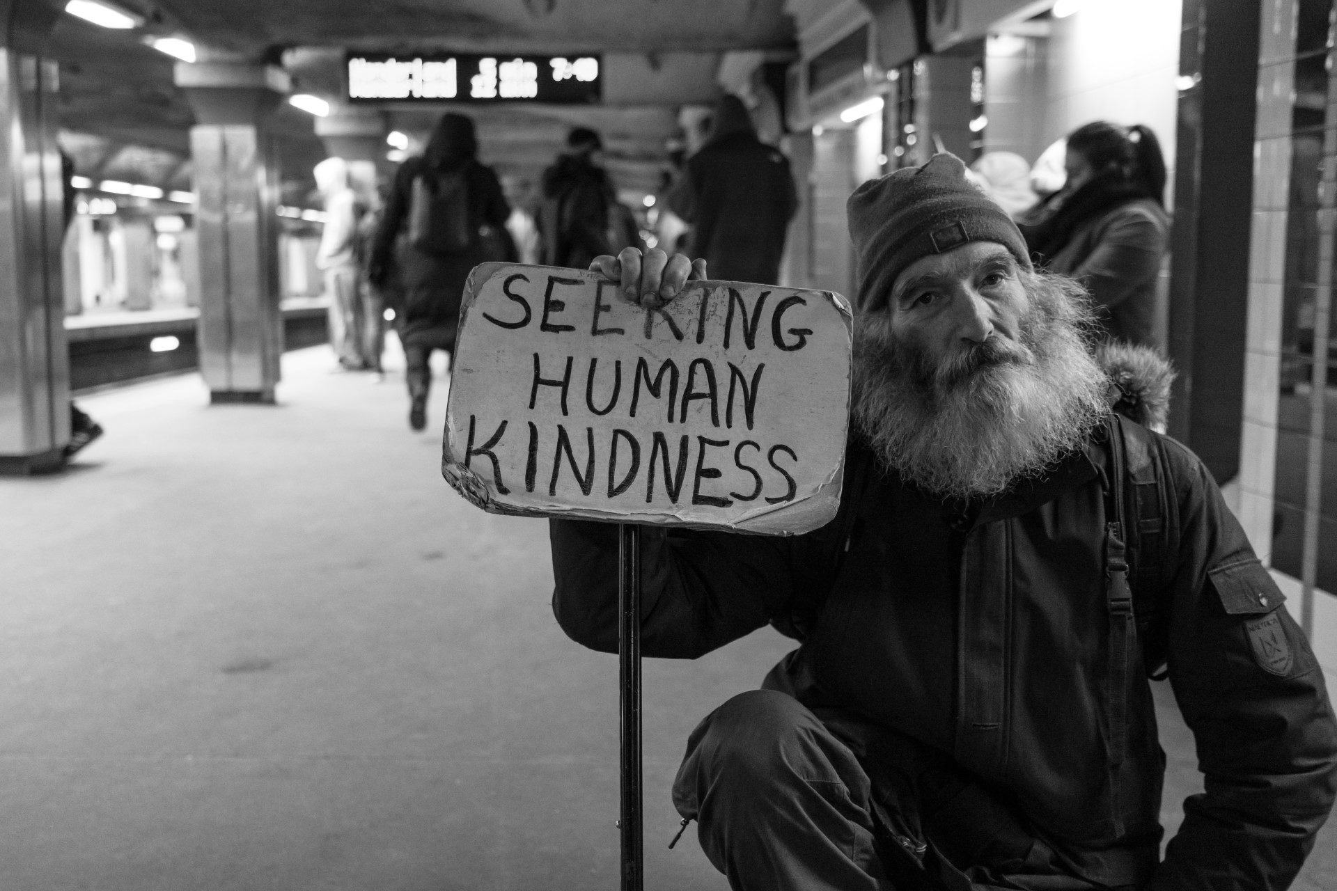 homeless person with sign