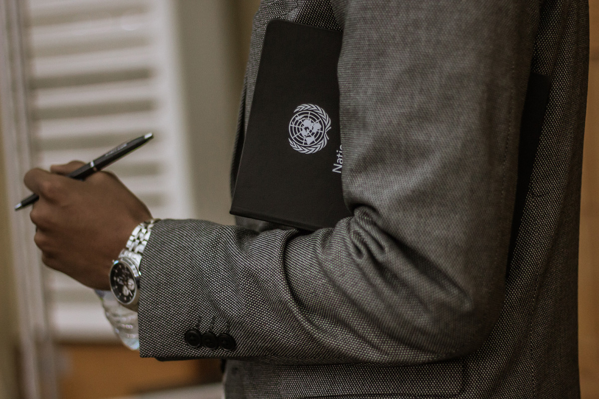 person holding a un portfolio