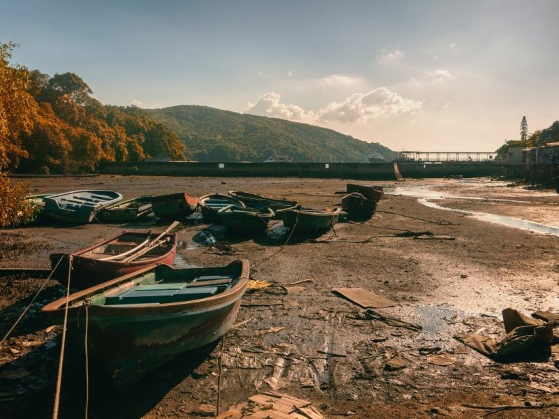 boats resting on a dry river