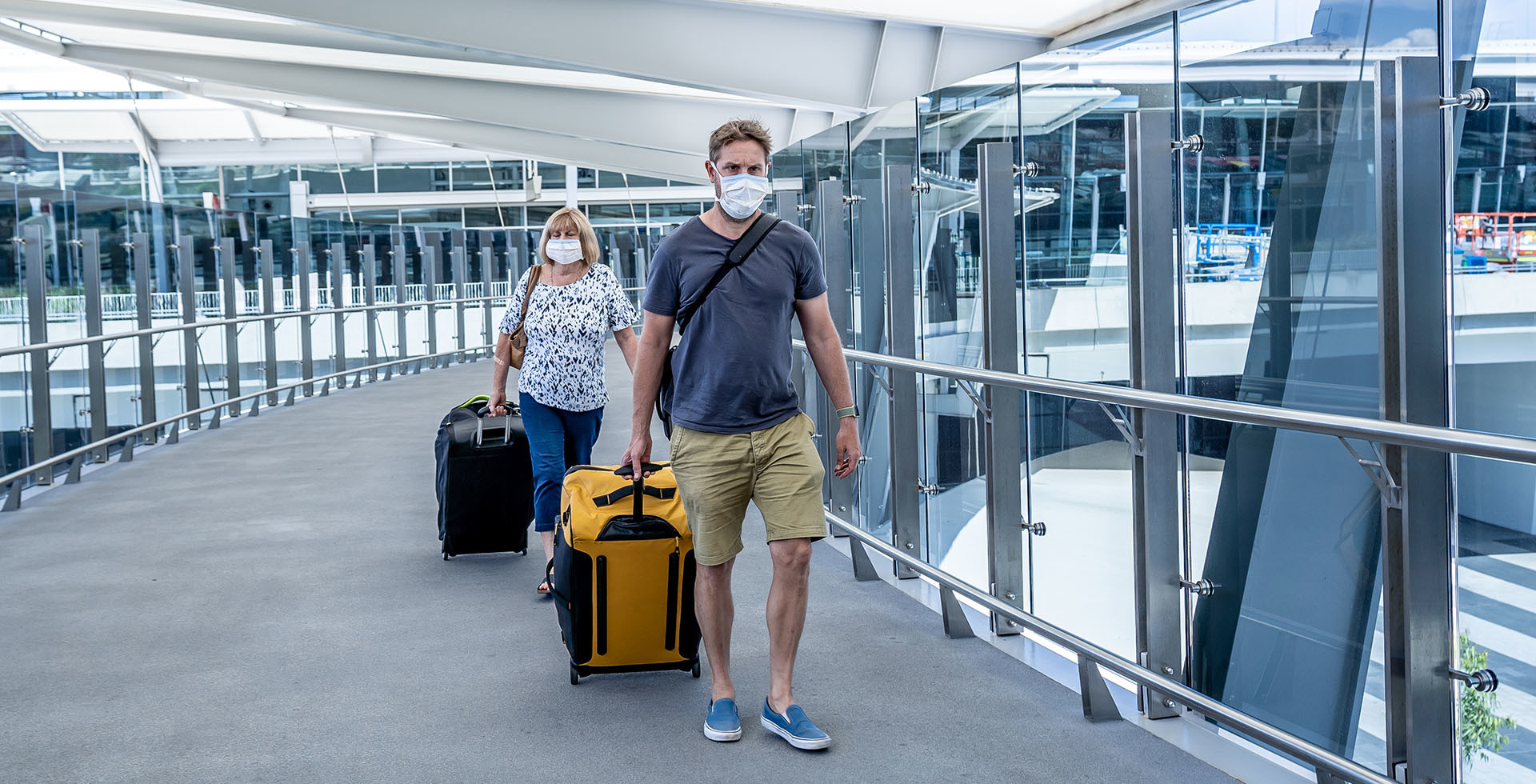 travelers with protective mask at an airport