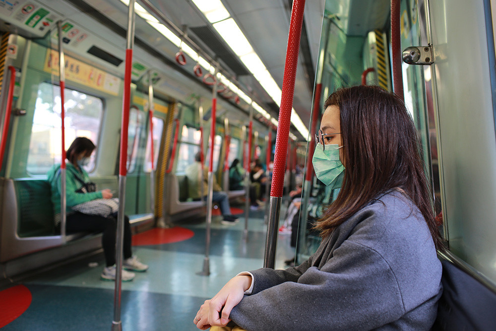 people in the subway wearing face masks