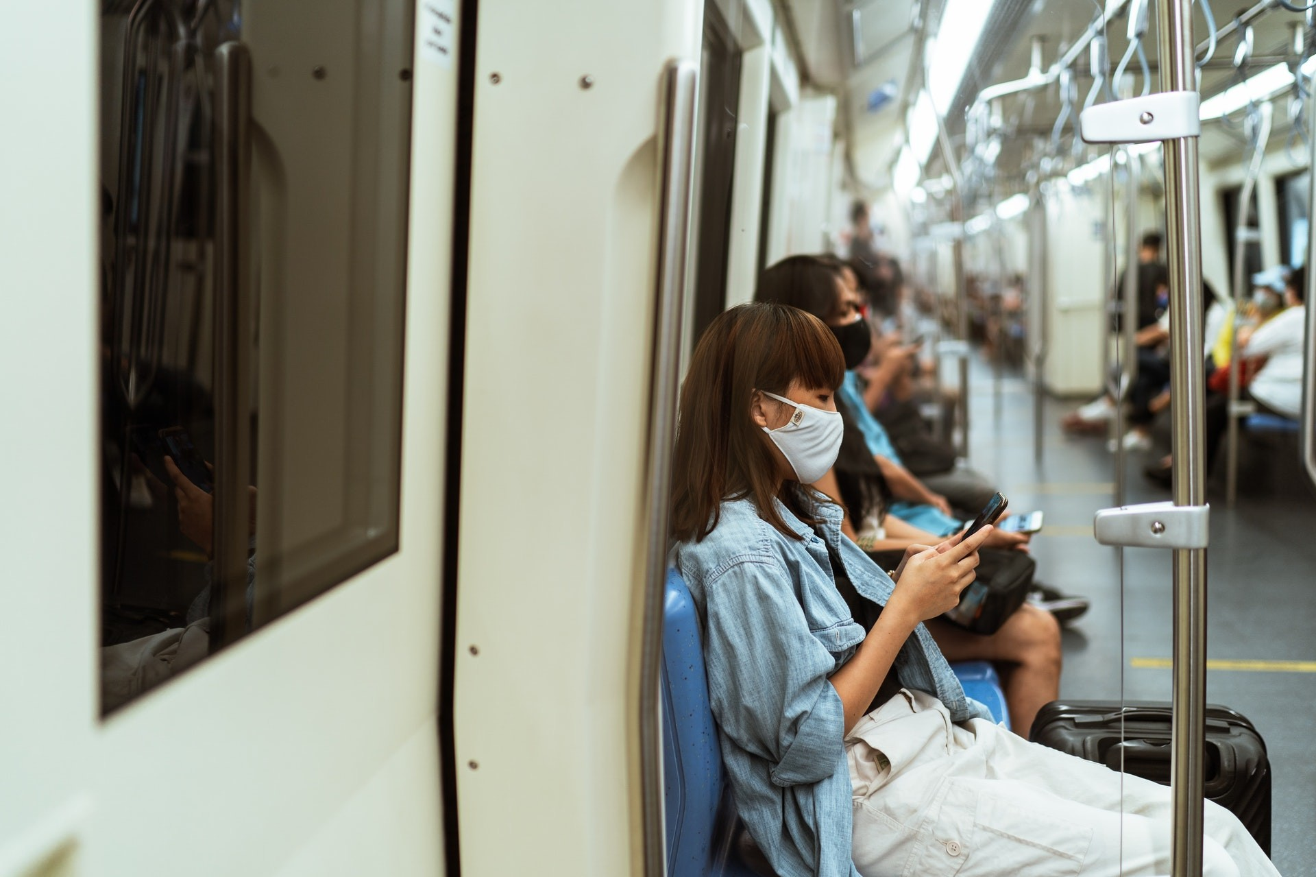 masked people in the subway