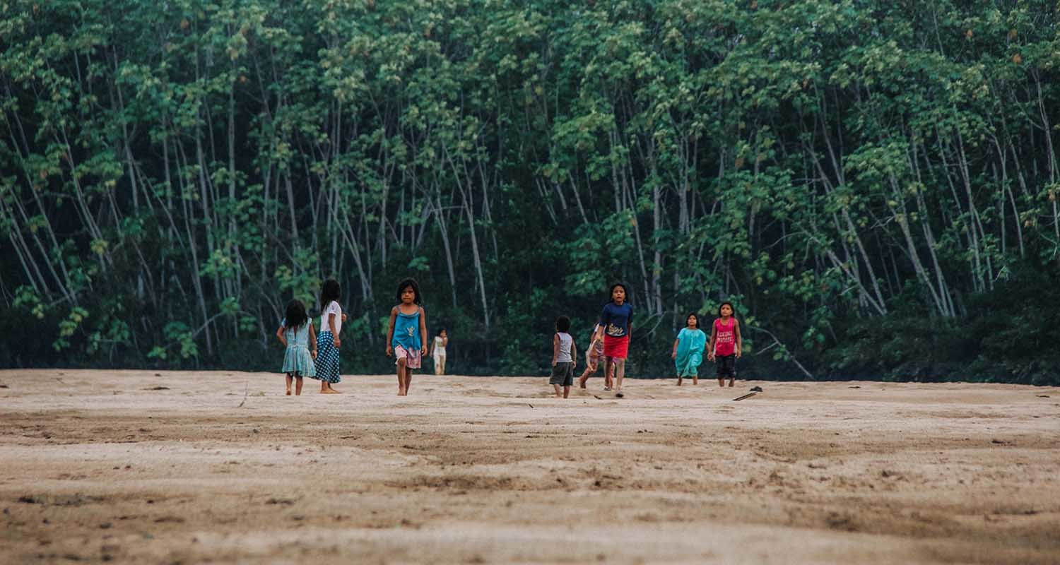 A group of indigenous koreguaje kids play by the beach